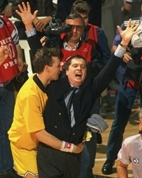 Dino Radja hugs head coach Bozidar Maljkovic after Jugoplastika Split had won its second consecutive European Cup title in 1990.